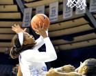 Stephanie Mavunga drives hard to the basket. Photo by Elliott Rubin