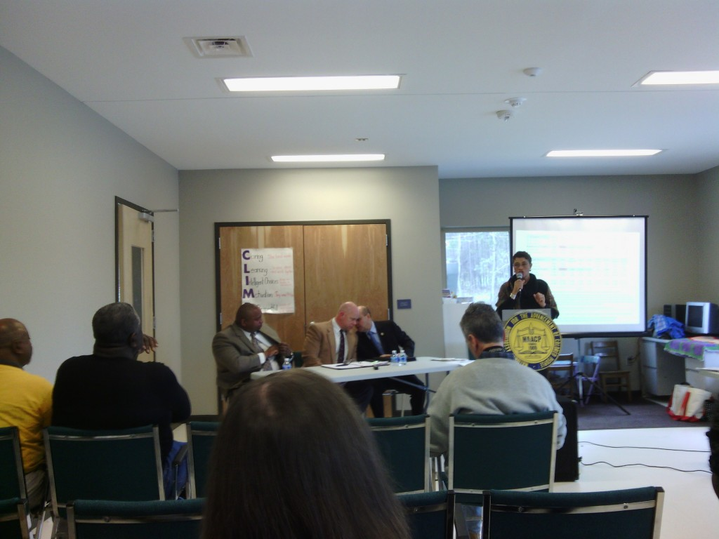 Diane Robertson questions the panelists. From L-R: Walter Horton, Chris Blue, Charles Blackwood.