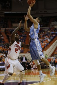 Marcus Paige jumps over a Tiger defender (Todd Melet)