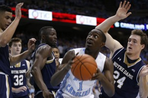 Theo Pinson fights for space inside (Todd Melet)