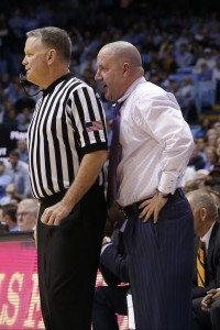 Buzz Williams breathes down the neck of an official (Todd Melet)