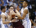 Marcus Paige and J.P. Tokoto clamp down on Devin Wilson (Todd Melet)