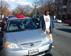 Sam McAdoo poses with his new car.