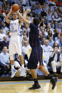Marcus Paige takes a jumper with a hand in his face (Todd Melet)