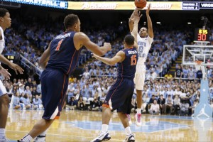 Nate Britt shoots over a pair of Cavalier defenders (Todd Melet
