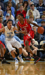Cat Barber dribbles around Marcus Paige (Wolfpack Athletics)