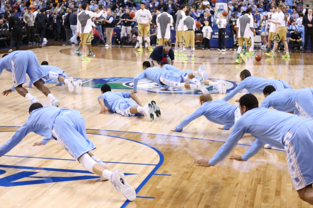 The Tar Heels dive to the floor in their pregame ritual (Todd Melet)