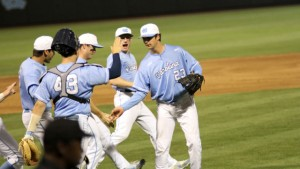 Teammates congratulate Zac Gallen after finishing off the ninth. (UNC Athletics)
