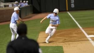 Brian Miller hustles around third base to score the game's first run on Tyler Ramirez's RBI single. (UNC Athletics)