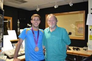 WCHL's own Ron Stutts in studio with Nick McCrory and his medal.