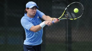 Ronnie Schneider strikes a backhand (UNC Athletics)