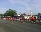 The Not So Normal 5K gets under way on Main Street. (Photo by Aaron Keck.)
