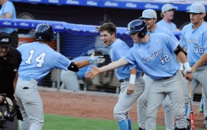 Teammates greet Tyler Ramirez (14) after he led off the game with a home run. (Liz Condo, TheACC.com)