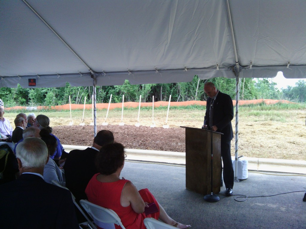 Brian Goldstein speaks at the groundbreaking. (Photo by Aaron Keck.)