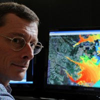Dr. Rick Leuttich, director of the UNC Institute of Marine Sciences and the UNC Center for Natural Hazards and Disasters, uses computer modeling to predict storm surge from hurricanes and the areas effected. Photo via UNC