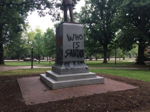 "Silent Sam spray painted with ""Who is Sandra Bland?"" Photo via Blake Hodge"