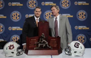 New UNC defensive coordinator Gene Chizik (left) ,shown here during his time at Auburn, has a history with South Carolina head coach Steve Spurrier (right). (Jacksonville.com)