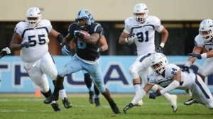 TJ Logan uses his speed to get away from potential tacklers. (UNC Athletics)