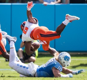 UNC linebacker Jeff Schoettmer makes the tackle. Photo via Smith Cameron Productions