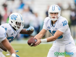 Mitch Trubisky (10) hands off to Romar Morris (21). Photo by Smith Cameron Photography.