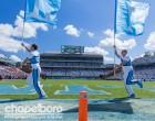UNC Cheerleaders hit the field. Photo via Smith Cameron Photography.