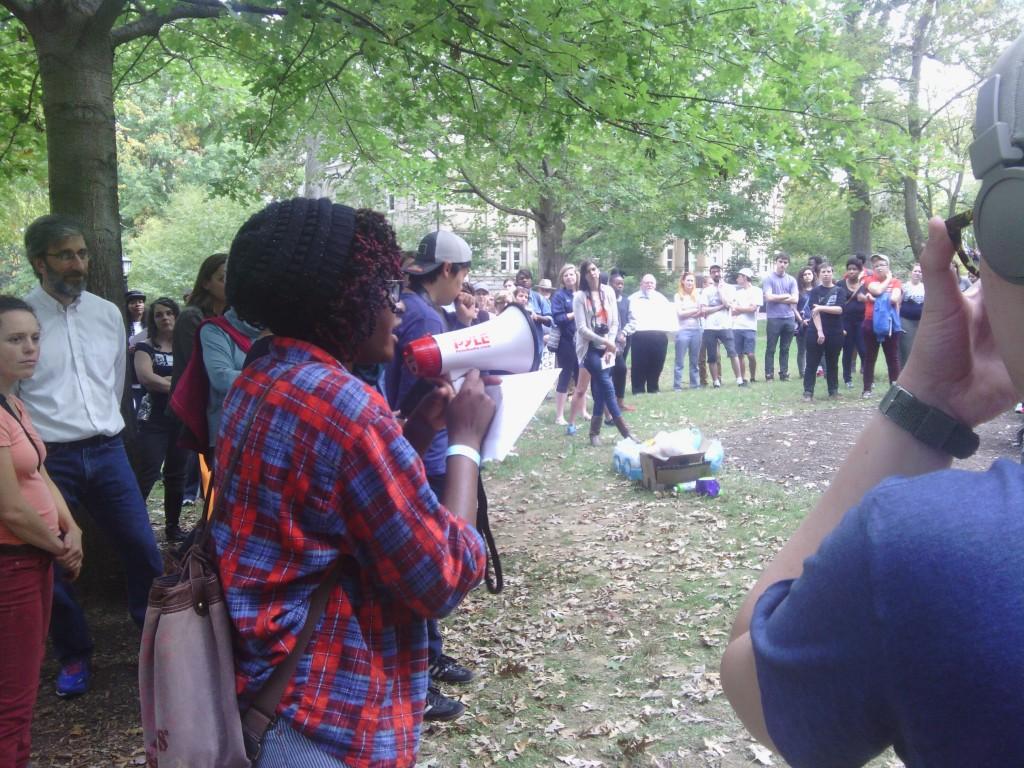 Leah Osae speaks to demonstrators.
