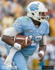 Marquise Williams carries the football. Photo via Smith Cameron Photography.