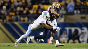 UNC cornerback MJ Stewart attempts to tackle Pitt star receiver Tyler Boyd. (UNC Athletics)