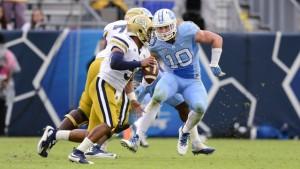 Linebacker Jeff Schoettmer (10) tracks down Tech quarterback Justin Thomas (5). (UNC Athletics)