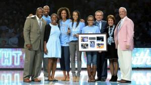 Sydni and Taelor Scott accept the Tar Heel Trailblazer award. (UNC Athletics)