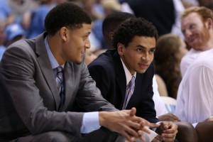Marcus Paige and Justin Jackson look on from the sidelines. (Todd Melet)