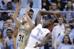Theo Pinson and Wofford's CJ Neumann scramble for a loose ball. (Todd Melet)