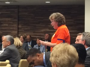 UNC Professor Altha Cravey protesting during the UNC Board of Governors meeting. Photo via Blake Hodge.