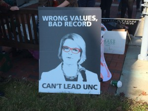 One of many signs at UNC Board of Governors meeting protesting hiring of Margaret Spellings as System President. Photo via Blake Hodge.
