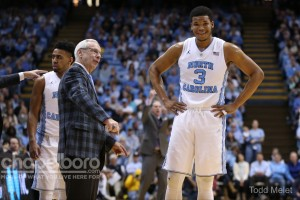 Roy Williams giving Kennedy Meeks some advice on the sideline in his first game since having a vertigo spell at Boston College. (Todd Melet)
