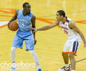 Virginia's Malcolm Brogdon (right), seen here defending UNC's Theo Pinson, left his mark all over the game.