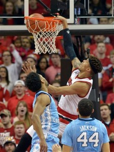 Damion Lee, who had 24 points for Louisville, dunks over Joel Berry. (AP Photo/ Timothy D. Easley)