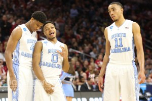 Isaiah Hicks (far left) knows he'll have big shoes to fill, as he takes over the starting role once occupied by Brice Johnson (right). (Todd Melet)
