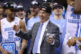 UNC head coach Roy Williams celebrates winning the ACC Championship over Virginia. (Todd Melet)