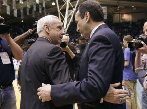North Carolina coach Roy Williams, left, and Duke coach Mike Krzyzewski speak. (AP Photo/Gerry Broome)