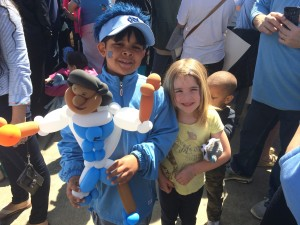 A couple of young fans with a balloon version of Marcus Paige.
