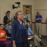 UNC - Chapel Hill professor Altha Cravey speaking at UNC Board of Governors public comment session. Photo via Blake Hodge.