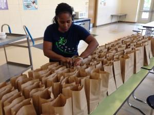 Essie Markham packs lunches at Northside Elementary School (Photo by Chris Grunert)
