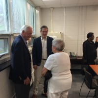 CHCCS Interim Superintendent Jim Causby (left) talks with board member Andrew Davidson (middle) and a resident (right).