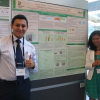 Peter Said and Qina Mo, two Durham Tech students, present a research poster at the 2016 SEA-PHAGES Symposium in June. Photo via Durham Tech