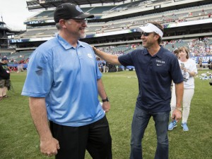 Joe Breschi (left) and Larry Fedora (right) spoke prior to Monday's championship game against Maryland. A number of UNC coaches voiced their support for both the men's and women's lacrosse teams over the weekend. (Jeffrey A. Camarati/ UNC Athletics)