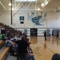Interim Principal Stephon Goode speaking to eighth graders at Smith Middle School. Photo via Blake Hodge.