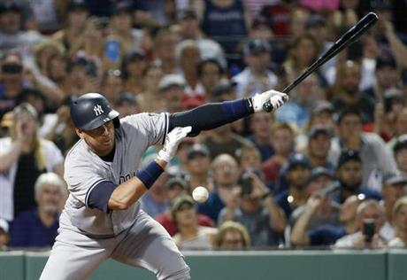 Yankees rally in 8th for 4-2 win at Boston