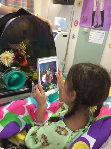 Nunez used an iPad app to save a picture of her flowers. Photo via Erin Wygant.