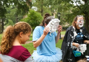A UNC student gets a pie in the face at the KFTK one-mile fun run. Photo via Carolina For The Kids.